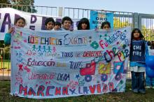 Young kids from the casa de l@s nin@s demonstrating for their rights